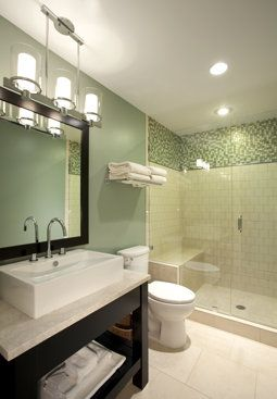 A utility bath needs only a toilet and basin, maybe a shower. Fancify it and it'll easily serve as a guest bath.