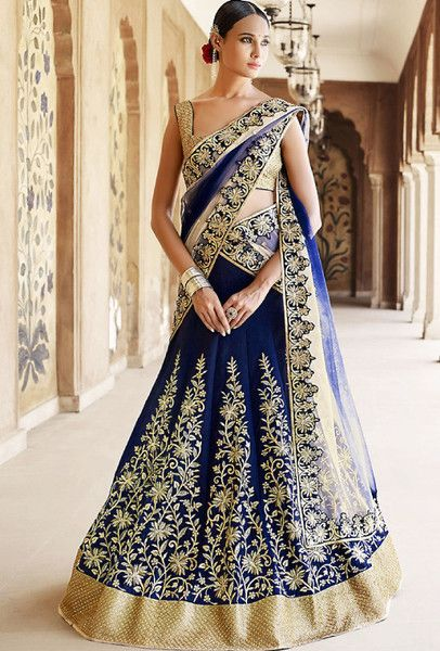 Limited stock left. PALLU: Pallu with double tone of beige to navy color on net fabric with stone work style border . SKIRT: Skirt in bhagalpuri fabric with heavy zari and stone work on it. BLOUSE: Bl