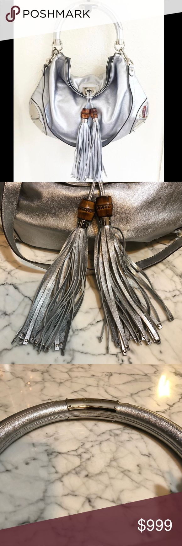 """Gucci Medium Indy Hobo EUC very minor scratches on corner hardware  metallic silver-tone smooth leather Gucci Medium Indy hobo with silver-tone hardware, tonal leather trim, single rolled top handle, metal plate accents at corners, paisley printed woven lining, dual pockets at interior walls; one with zip closure and fold-over flap closure featuring bamboo tassel accent at front.  5"""" drop handle  Detachable shoulder strap 16"""" drop  H12xW15xD2 inches Gucci Bags Hobos"""