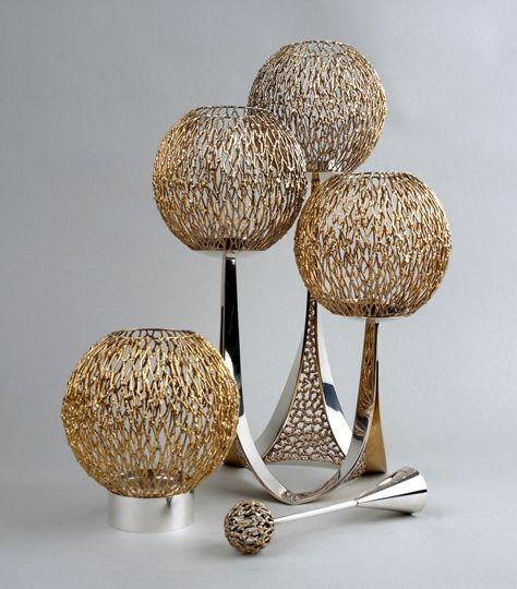 Stuart Devlin 1960s suite of silver-gilt globe candelabra, candle holder and snuffer @ silvervaultslondon.com