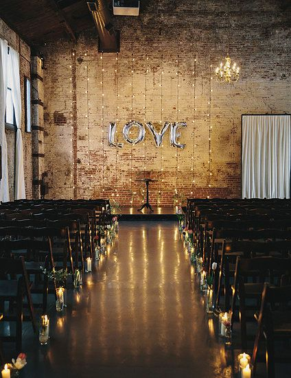 Romantic and edgy ceremony space by Whimsy Weddings. www.whimsy-weddings.com - Photo by http://www.cleanplatepictures.com - Flowers by http://mollyoliverculver.com