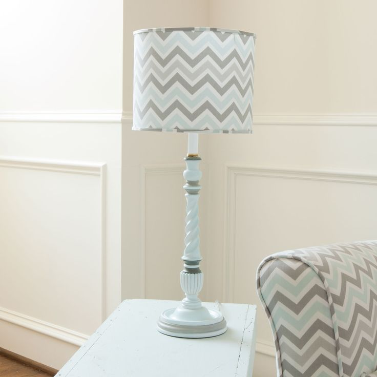 Gray and Mist Lamp with Shade from Carousel Designs.  Our exclusive hand painted twist lamp base features a medium drum shade. Adorned with our Mist and Gray Chevron fabric this modern and contemporary lamp is sure to be a focal point in any room.