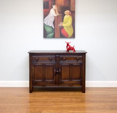 Delightful Ercol sideboard ... solid English oak, rustic peg joins & clever slide lock.  Made in England circa 1960's