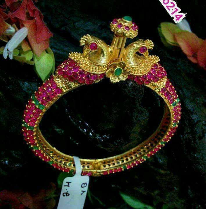 Available . Beautiful bangle with peacock design. Bangle studded with pink and green color stones. To order WhatsApp 8897313363.