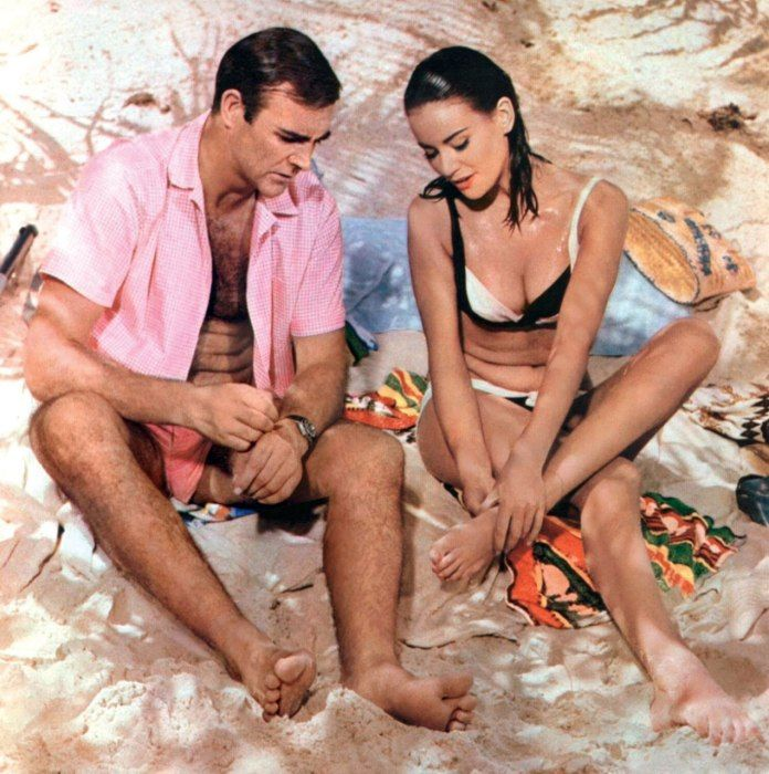 50 Years of James Bond on Film. With Claudine Auger in a still from the movie.