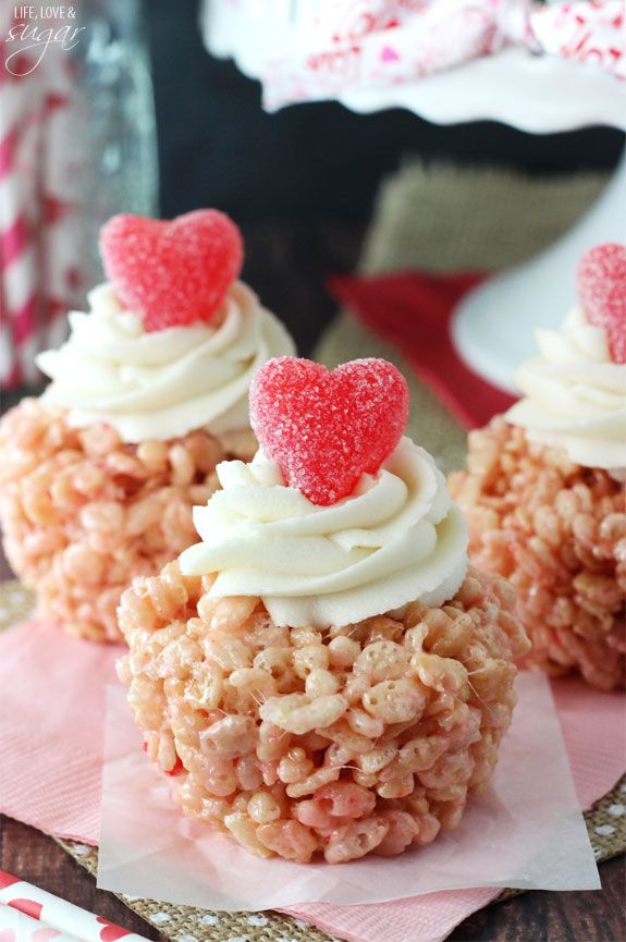 Valentines Day Rice Krispie Treat Cupcakes - strawberry cake batter rice kris pie treat topped with icing and a gummy heart!