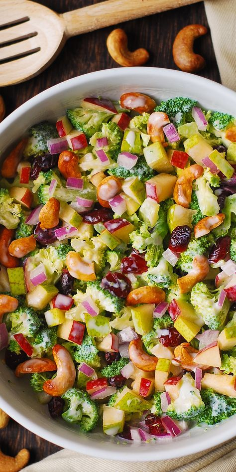 Winter Salad: Broccoli, Cashew, Apple and Pear Salad with Cranberries and chopped red onions with the most delicious homemade salad dressing, made with mayonnaise, sour cream (or kefir or Greek yogurt), honey, and lemon juice!