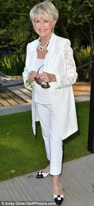 Coordinated: Gloria Hunniford looked elegant in her white lace jacket
