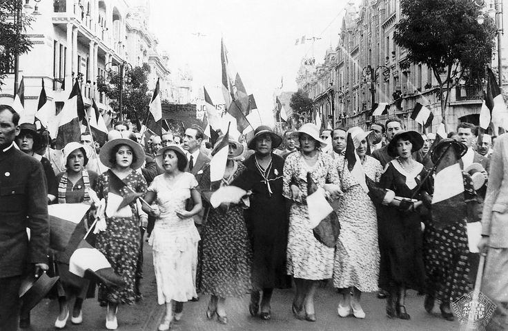 (Original Caption) 3/1/1933-Lima, Peru: ORIGINAL CAPTION READS: These fashionably-dressed women of Lima are shown marching thrugh the main streets of the city singing the national anthem during the demonstration in favor of (_-missing word) Colombia, in which hundreds of thousands marched. via @AOL_Lifestyle Read more: https://www.aol.com/article/news/2017/03/07/51-powerful-photos-of-women-marching-throughout-history/21875571/?a_dgi=aolshare_pinterest#fullscreen