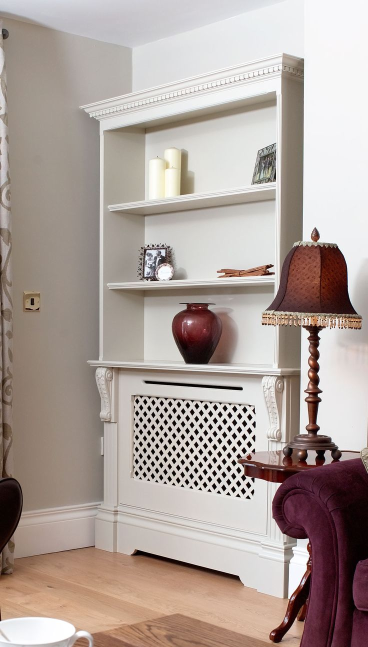 Radiator cover and shelves - you could do something like this on the wall behind the sofa and use it to display your pottery collection. Then we can move the tulip painting to one of the walls behind the TV.