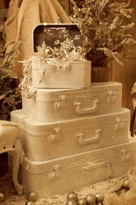 Christmas theme painted suitcases vignette
