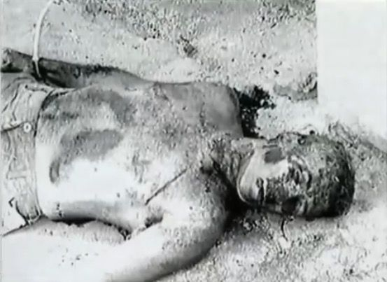 The mutilated body of a U.S. serviceman in Mogadishu, Somalia on October 3rd 1993 after the raid that is more popularly known as Black Hawk Down. This is possibly the body of Randy Shughart due to some resemblance in the face, though this is not confirmed.