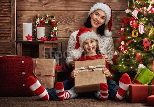 Mother and daughter exchanging gifts stock photo (c) choreograph (#7451700) | Stockfresh