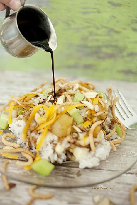 Fun Summer Recipe! Hawaiian Haystacks recipe has a rice base, white sauce, cheese, pineapples, coconut, chow mein noodles, celery, almonds, cheese, and soy sauce.