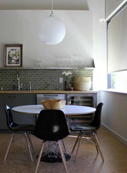 v. simple eat in kitchen: eames daw chairs w. noguchi cyclone table #pendant lamp #greentilebacksplash
