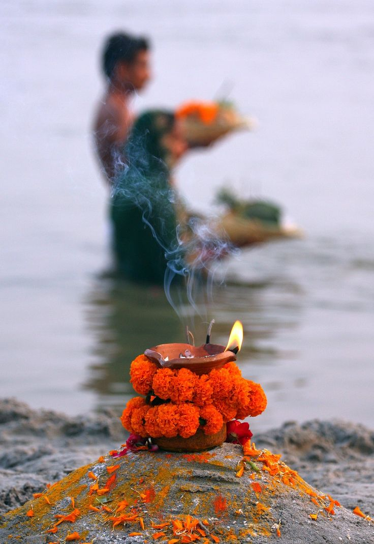 Another powerful picture. Hindu devotees perform religious rituals as they offer prayers to the Sun God at