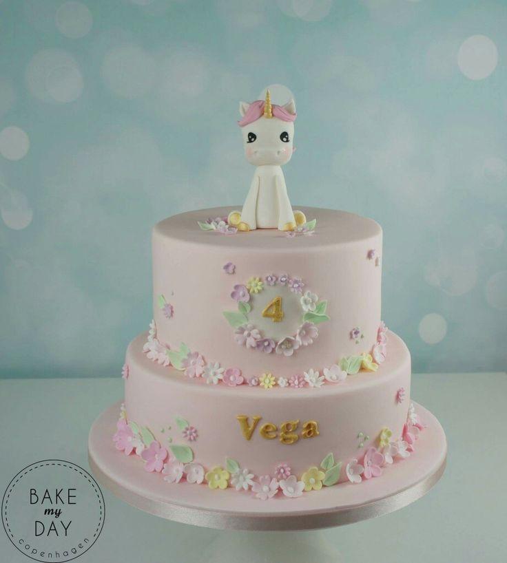 Unicorn pink tiered birthday cake with flowers