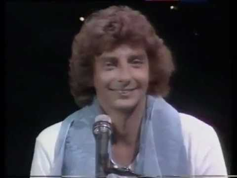 I Write the Songs - Barry Manilow  His number one song from 1976. This song was number one for one week.  A live performance.