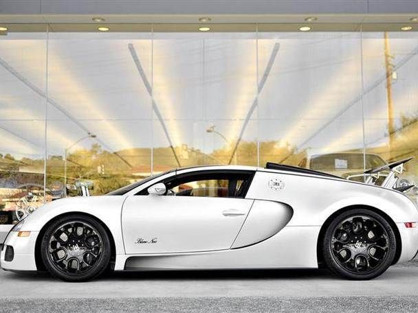 Enter the Bugatti Veyron 16.4 Grand Sport Blanc Noir.  With 1,001 horsepower and a top speed in excess of 250 mph, the Blanc Noir is clearly akin to all Bugatti vehicles but it is in its livery and refinement   from the matte pearl white finish of its exterior to the smallest stitch of the interior   that its exceptional nature becomes fully apparent