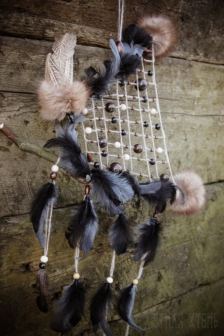 A lot of feathers, fur and wooden beads - for cozy dreaming during long winter nights