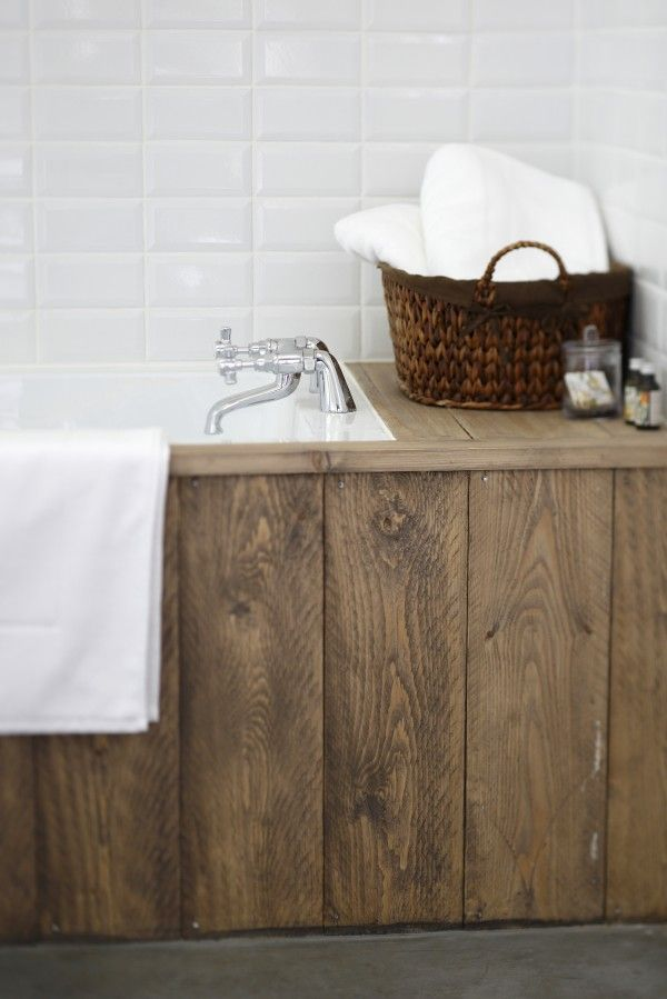 bathtub with wood  planks Could use composite boards instead.
