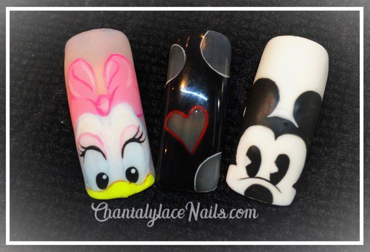 mickey mouse nail art , daisy nail art