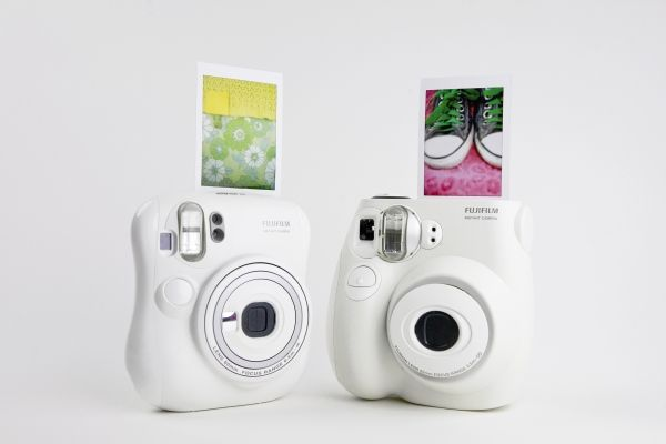 Instax Mini 7s and Mini 25 Instant Cameras - Make sharp, saturated, credit card-sized photos that develop instantly.  I just got the Mini 25.