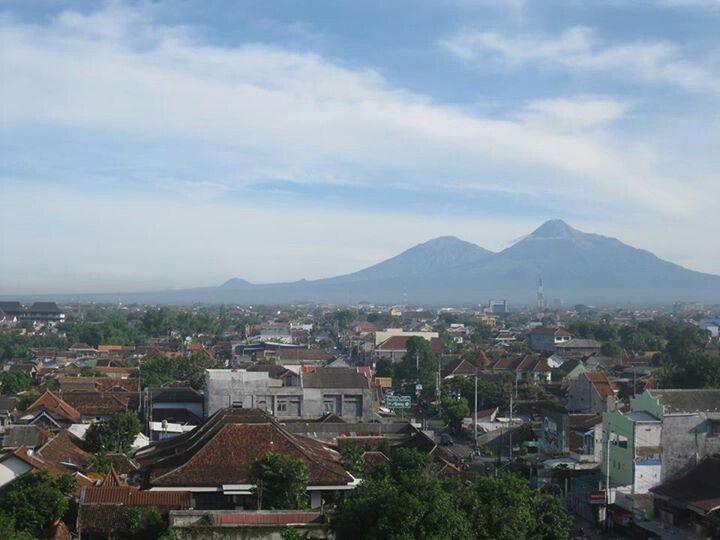 Merapi and Merbabu Mt from Edu Hostel's roof top. Yogyakarta City.