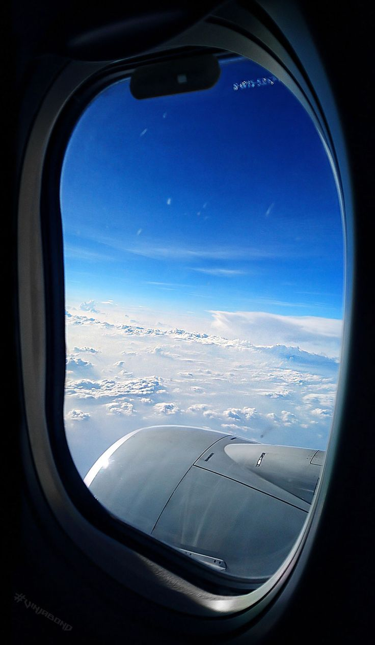 Flight window view above the clouds. As the saying goes, the journey is just as important as the destination… In this case Chiang Mai of Thailand.