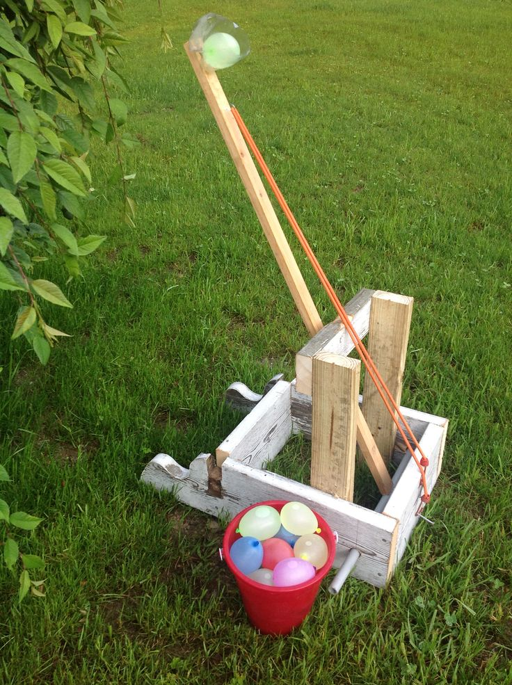Day 21 - Water Balloon Catapult. With the forecast of humid in the mid-90s, it seemed like a good day to make one of these. Scrap wood, PVC conduit and a bungee cord. #30DoC @createstuff