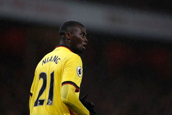 Watford's French striker M'Baye Niang reacts during the English Premier League football match between Arsenal and Watford at the Emirates Stadium in London on January 31, 2017.  / AFP / Adrian DENNIS / RESTRICTED TO EDITORIAL USE. No use with unauthorized audio, video, data, fixture lists, club/league logos or 'live' services. Online in-match use limited to 75 images, no video emulation. No use in betting, games or single club/league/player publications.  /