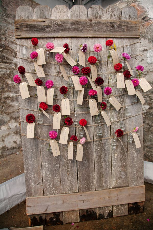 seating chart with bud vases - photo by Imagen Photos http://ruffledblog.com/california-winery-wedding-with-fuchsia-accents