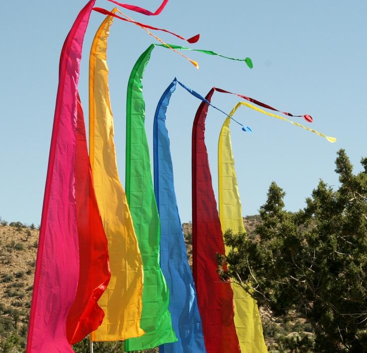 colorful tall rainbow flags