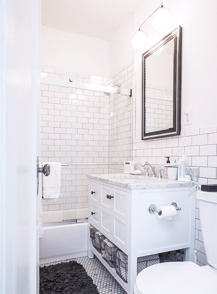 White subway and marble hex tile with charcoal grout. A 150-year-old Apartment in Brooklyn Heights | Design*Sponge