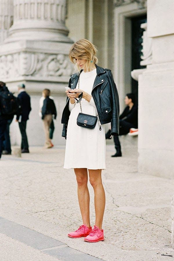 Shop this look for $76:  http://lookastic.com/women/looks/black-jacket-and-black-crossbody-bag-and-white-skater-dress-and-neon-pink-low-top-sneakers/1462  — Black Leather Jacket  — Black Quilted Leather Crossbody Bag  — White Skater Dress  — Neon Pink Low Top Sneakers