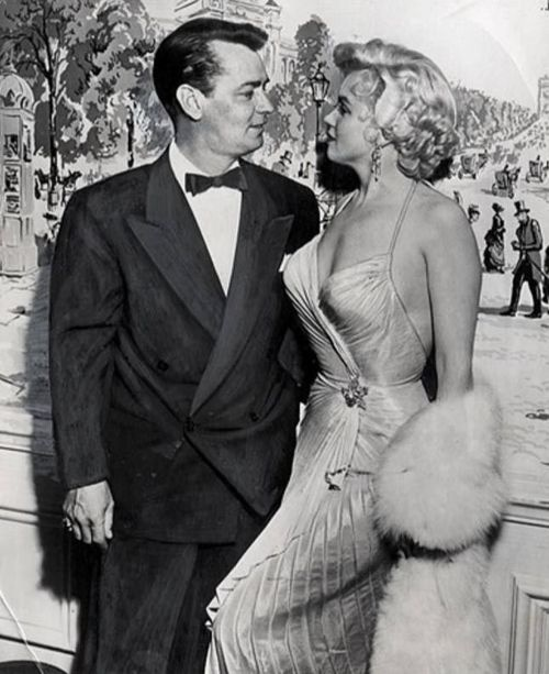 """March 9, 1954:Marilyn Monroe received the """"PhotoplayMagazineAward"""" for """"The Most Popular Actress in 1953"""", posing with Alan Ladd."""