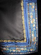 Beltestakkforkle med blå band