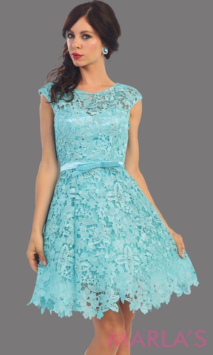 06b7cf0d203 Short aqua lace high neck dress with a satin bow. This light blue dress has  a flowy skirt. It is perfect for grade 8 graduation dress