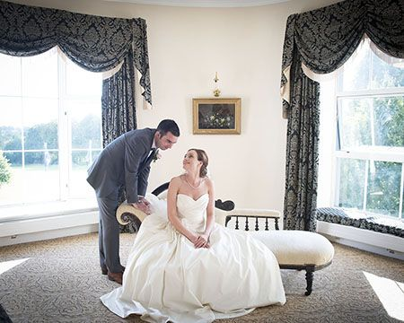 Bride and groom loving looking at each other in the bridal suite in The Castleoaks Hotel, Limerick