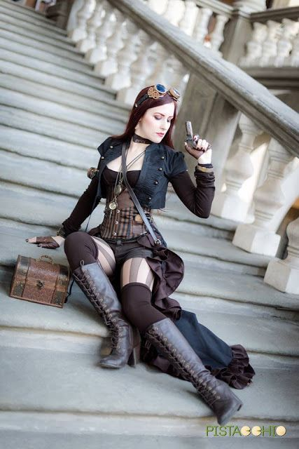 Redheaded Steampunk Huntress  - For costume tutorials, clothing guide, fashion inspiration photo gallery, calendar of Steampunk events, & more, visit SteampunkFashionGuide.com
