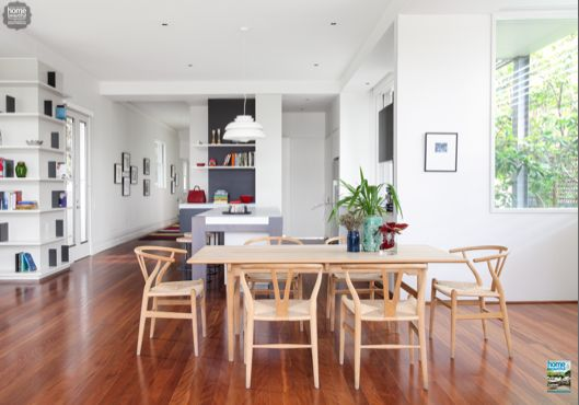 This open-plan kitchen has a relaxed 'living room' feel thanks to the open shelving