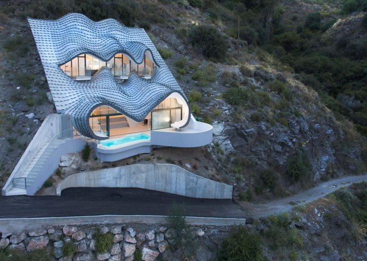 Unique Home Looks Like a Dragon Emerging From Cliffside  Read more: http://freshome.com/unique-cliffside-home#ixzz45kA5f2ZO  Follow us: @freshome on Twitter | freshome on Facebook