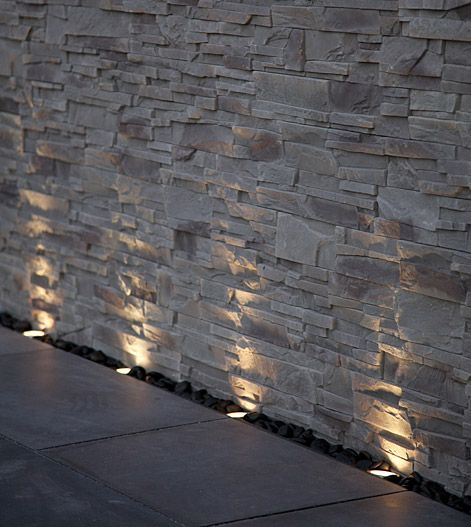 spotlight on stone wall