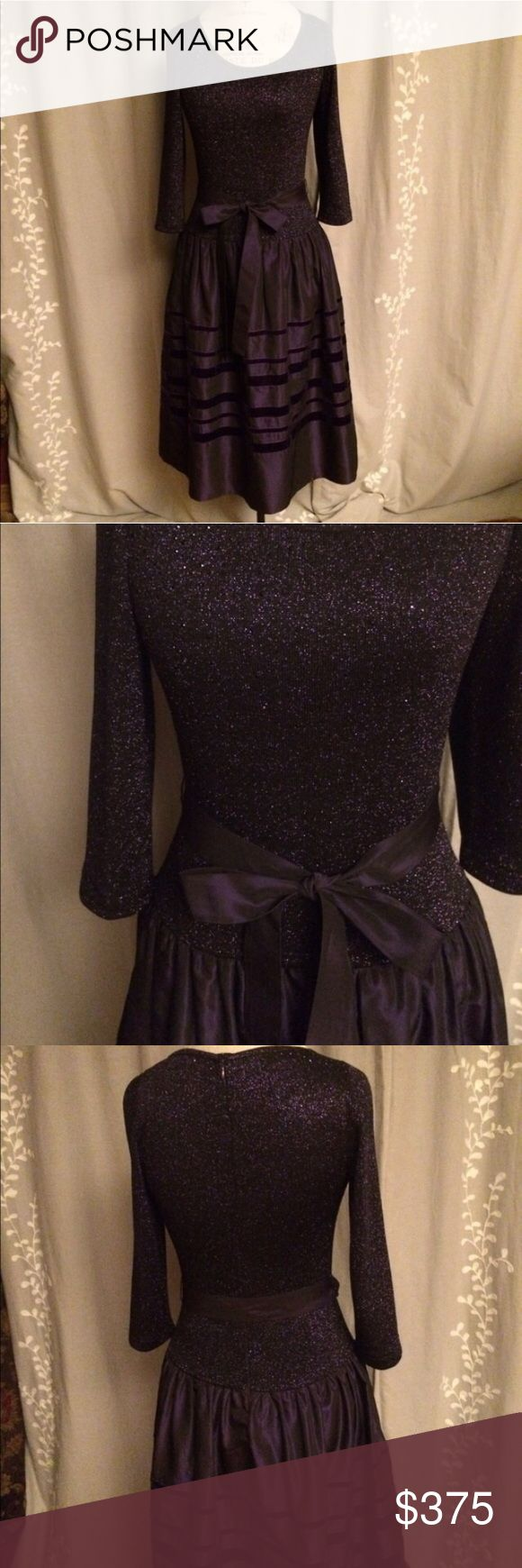 """St. John purple festive dress Only worn twice, fabulous dark purple dress with sparkly stretchy top. Very versatile and figure flattering. Perfect for any special occasion!  Measurements: breast 34"""" but can stretch up to 38"""",  waist 32"""". St. John Dresses"""
