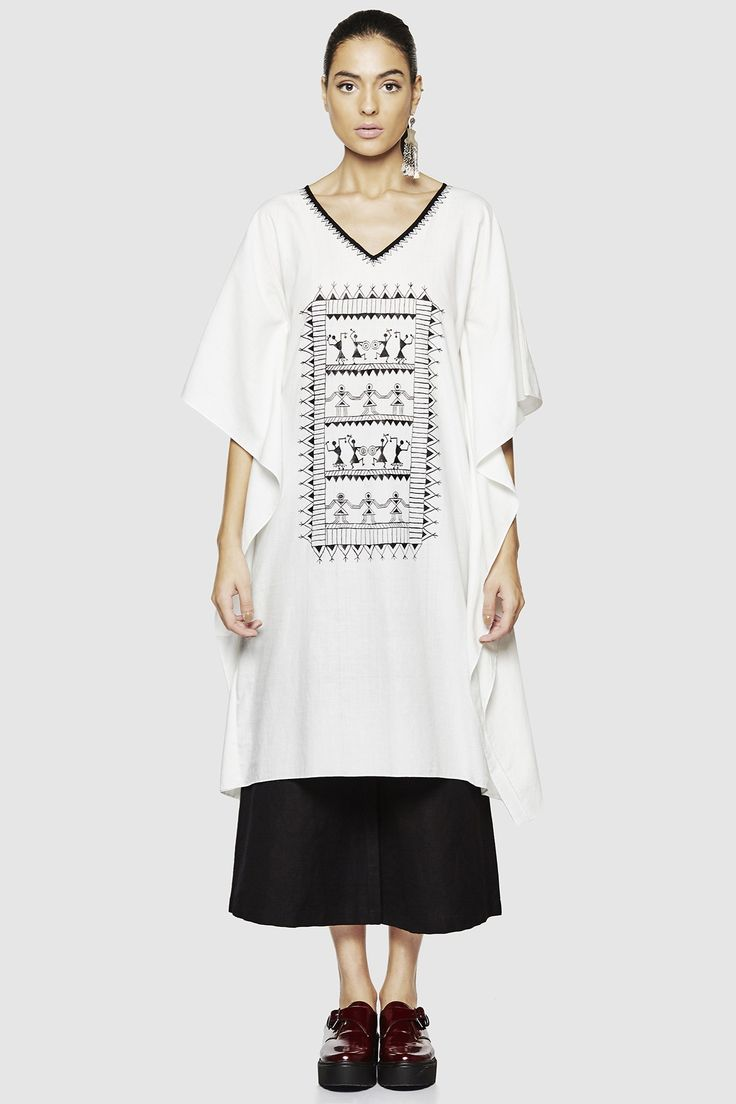 <p>The Warli Katha Collection presents a V-neck, asymmetrically cut kaftan with an intricate Warli painted front.  </p>$7,990.00