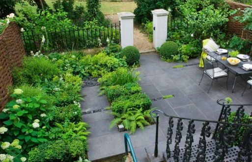Dark Grey slabs can look lovely with lush green planting...
