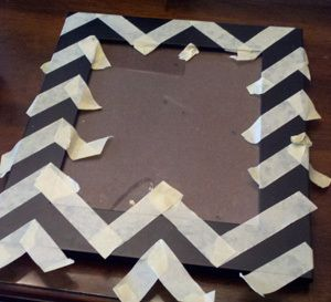 DIY chevron painted frame... get a cheap frame and paint it yourself with a cute chevron pattern!