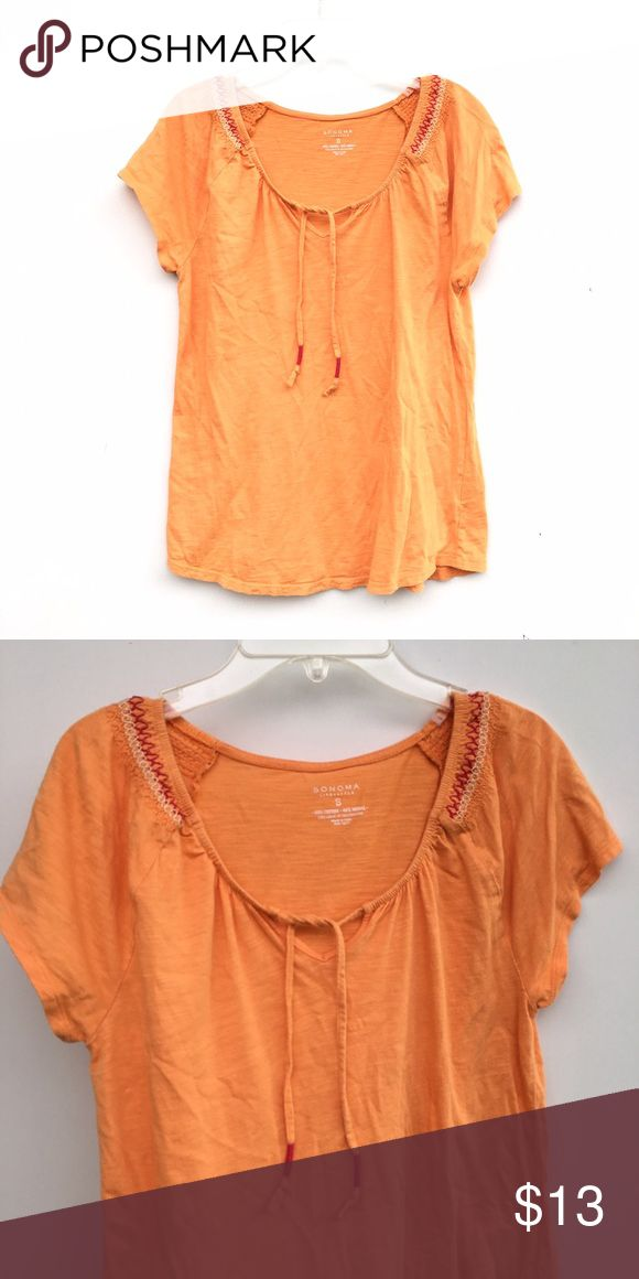 Orange Printed Top Bright orange top with a tie in front, and designing on each shoulder. Sonoma Tops Tees - Short Sleeve