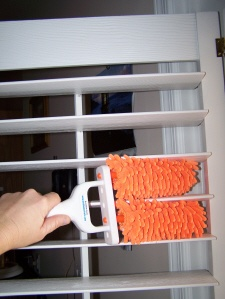 """Available at www.GetShutterParts.com  This adjustable duster can be used to clean 1"""", 2"""", 3"""" or 4"""" blinds or shutters as well as other surfaces such as wood, glass, metal, plastic or tile. Product has re-usable, re-washable, re-fillable microfiber noodles. You can use one, two or all three of the dusting fingers to clean. The dusting fingers spin 360 degrees to easily clean a variety of surfaces."""