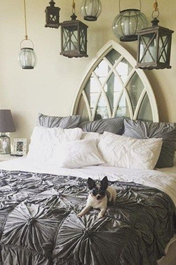 Something very alluring about the collection of lanterns and unique window headboard